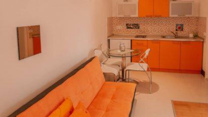 Sofa and kitchen